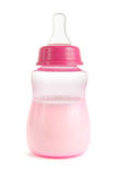 Pink babies bottle on white Stock Photo