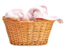 Pink Baby Blanket. Soft pink baby blanket in a wicker basket, isolated on white Stock Photography