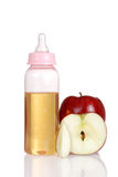 Pink baby bottle with fresh apple juice Royalty Free Stock Image