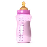 Pink baby bottle Stock Images