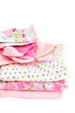 Pink Baby Clothes. Pile of pink baby clothes, isolated on white royalty free stock image