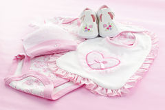 Pink baby clothes for infant girl. Pink infant girl clothing for baby shower Stock Photos