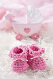 Pink baby crochet shoes Stock Photo