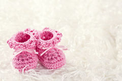 Pink baby crochet shoes Stock Images