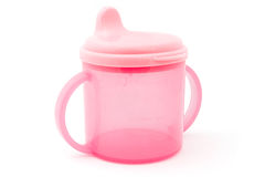 Pink baby cup over white Royalty Free Stock Images