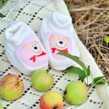 Pink baby girl shoes. On nature backgrond Royalty Free Stock Photo