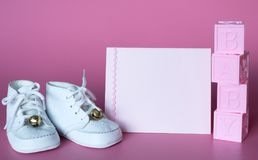 Pink Baby Girls Baby Shower or Birth Announcement Card with Vintage Shoes and Blocks.  Horizontal photo with side angled view and Royalty Free Stock Photos
