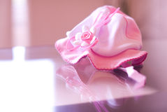 Pink baby hat. On pink background Stock Photos