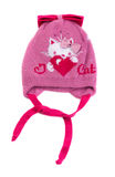 Pink baby hat with laces. Royalty Free Stock Photography
