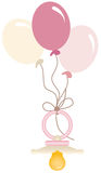 Pink baby pacifier with balloons Royalty Free Stock Photo