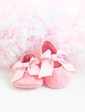 Pink Baby's bootees. Pair of pink bootees close-up Stock Image