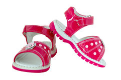 Pink baby's sandals. Brightly coloured. On isolated background stock photo