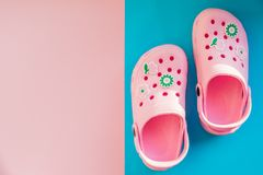 Pink baby sandals on a blue pink, rose background. Summer shoes. Copy space. Summer beach fashion. kids slippers royalty free stock photo