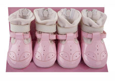 Pink baby shoes Stock Photos