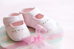 Pink baby shoes. Pink corduroy baby shoes for a baby girl stock photo