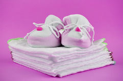 Pink Baby Shoes on Cotton Diapers Royalty Free Stock Photography