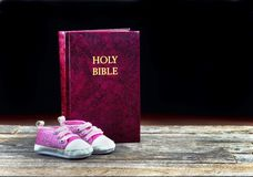 Babies and Bibles. Stock Photography
