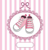 Pink baby shoes and lace frame Stock Photography