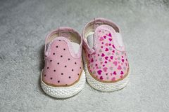 Pink baby shoes. On white textured background royalty free stock photography