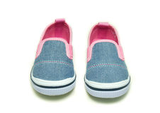 Pink baby shoes sneakers. On White background Royalty Free Stock Photo