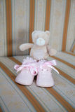 Pink baby shoes with teddy bear Stock Photo