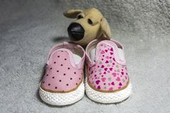 Pink baby shoes. On white textured background stock photo