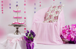 Pink baby shower decor. With garland and dessert table Royalty Free Stock Images