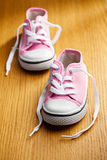 Pink baby sneakers Royalty Free Stock Image