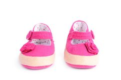 Pink baby sneakers on white background Stock Image