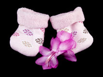 Pink baby socks on black Royalty Free Stock Photo