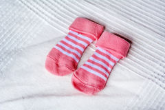 Pink baby socks stock photo