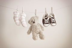 Pink baby socks and teddy bear with copy space Stock Photography