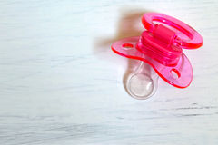 Pink baby soother. On white background stock photos