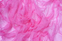 Pink background. Pink cloth background with beautiful foldings Stock Photo