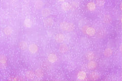 A pink background. An abstract background in pink white colors with white bokeh and floating bubbles Stock Photos