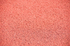 Pink background, asphalt pavement. Royalty Free Stock Images