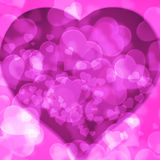 Pink background blurred lights heart. Pink background of blurred lights in the shape of a heart Stock Photo