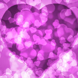 Pink background blurred lights heart. Pink background of blurred lights in the shape of a heart Royalty Free Stock Image