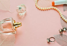 Pink background with bottle perfume Stock Photography