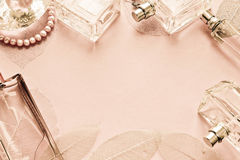 Pink background with bottles perfume Stock Images