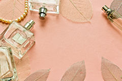 Pink background with bottles perfume Royalty Free Stock Photo
