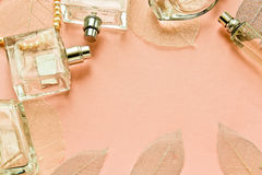 Pink background with bottles perfume Royalty Free Stock Photos