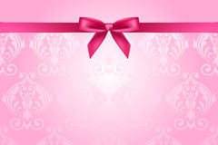 Pink background with bow Stock Photography
