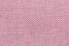 Pink background with checkered pattern, closeup. Structure of the fabric macro. Royalty Free Stock Image