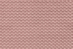 Pink background of dense woven bagging fabric, closeup. Structure of the textile macro. Royalty Free Stock Images