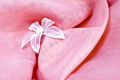 Pink background with a flower Stock Images