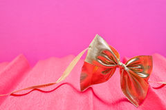 Pink background with golden ribbon Royalty Free Stock Images