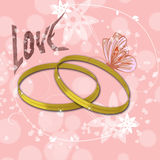 Pink background with golden rings and the inscription  love. Sparkling gold rings in the center. butterfly sitting on one ring. Left signature love. pink Stock Images