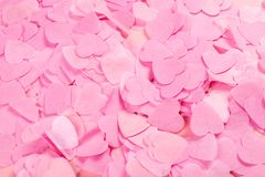 Pink background with heart-shaped confetti royalty free stock images