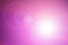 Pink background with lens flare Royalty Free Stock Images